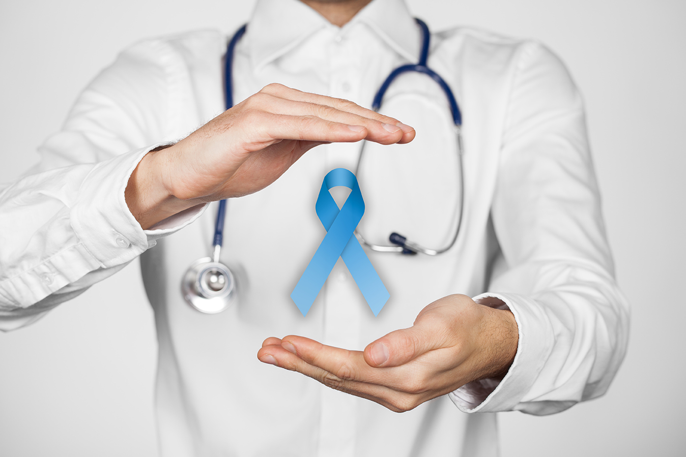 Prostate cancer prevention and genetic disorder awareness - doctor (general practitioner) with protective and support gesture and blue ribbon.