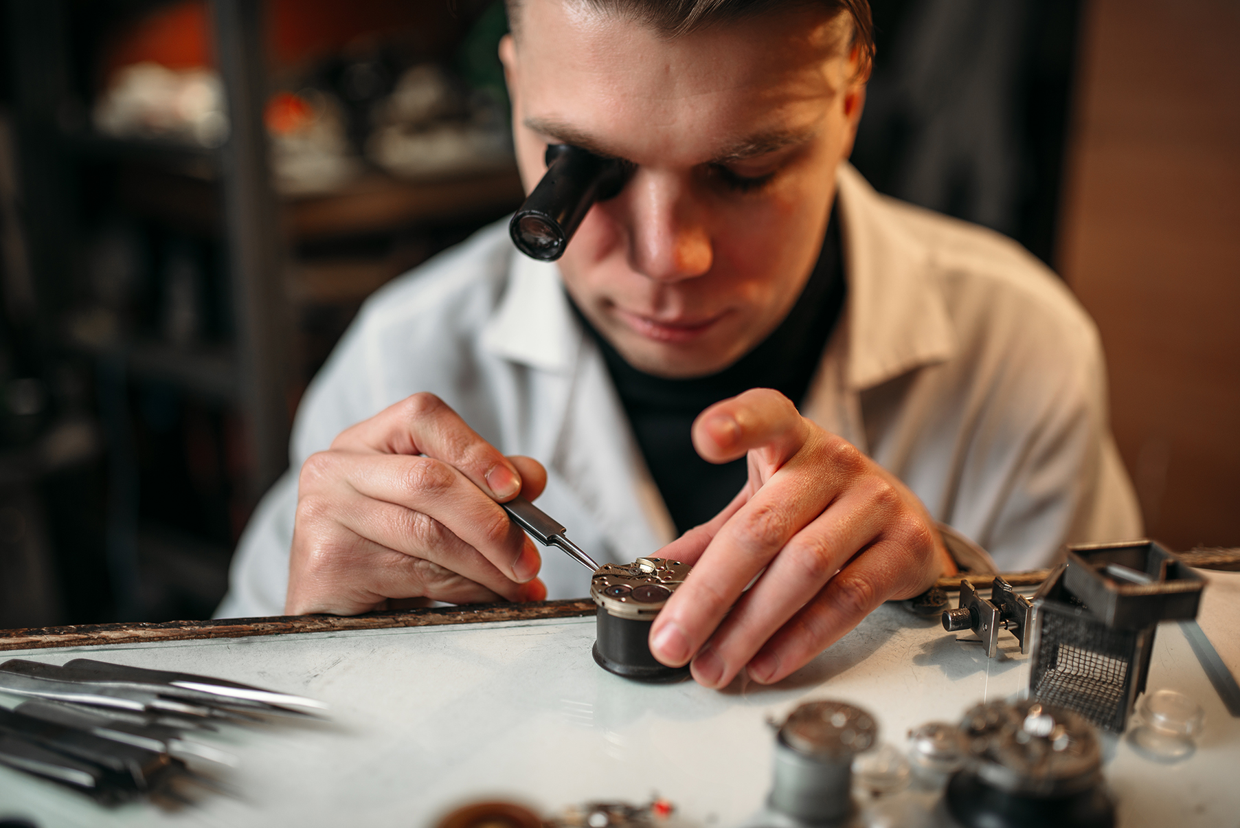 Clock maker repair old clockwork gear. Mechanical watches repairing