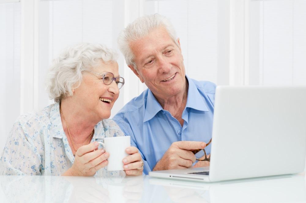 Senior couple at laptop