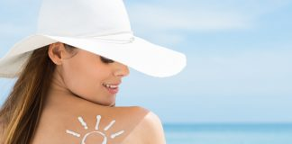 Sun Drawn On Woman's Shoulder With Sun Protection