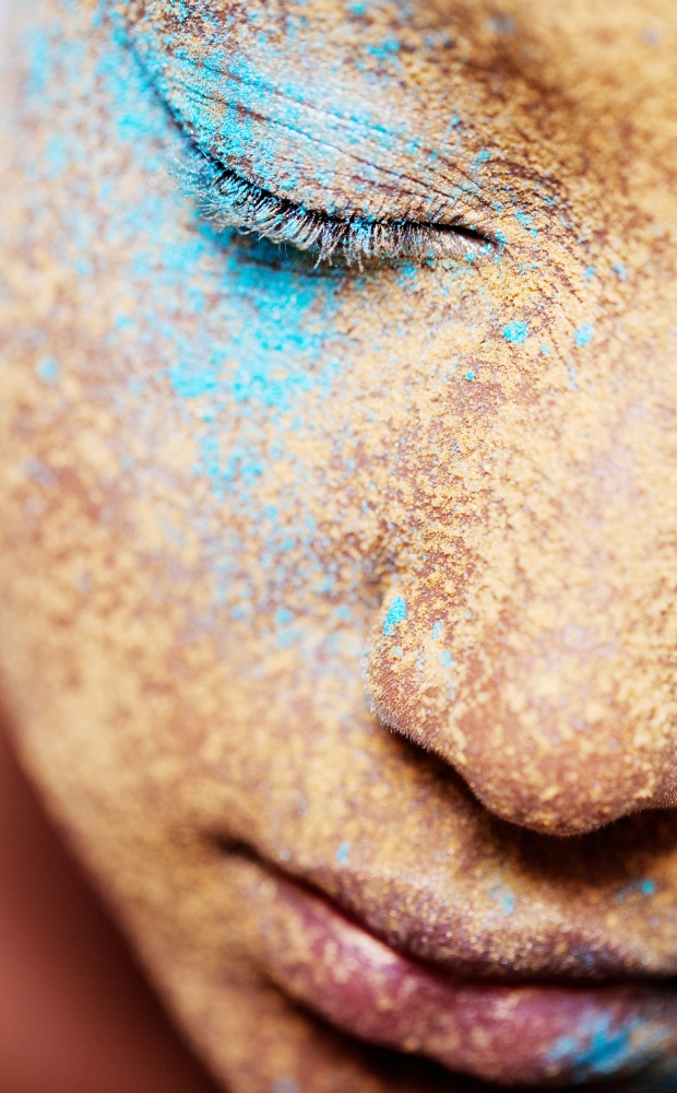 Girl face with makeup powder pigment